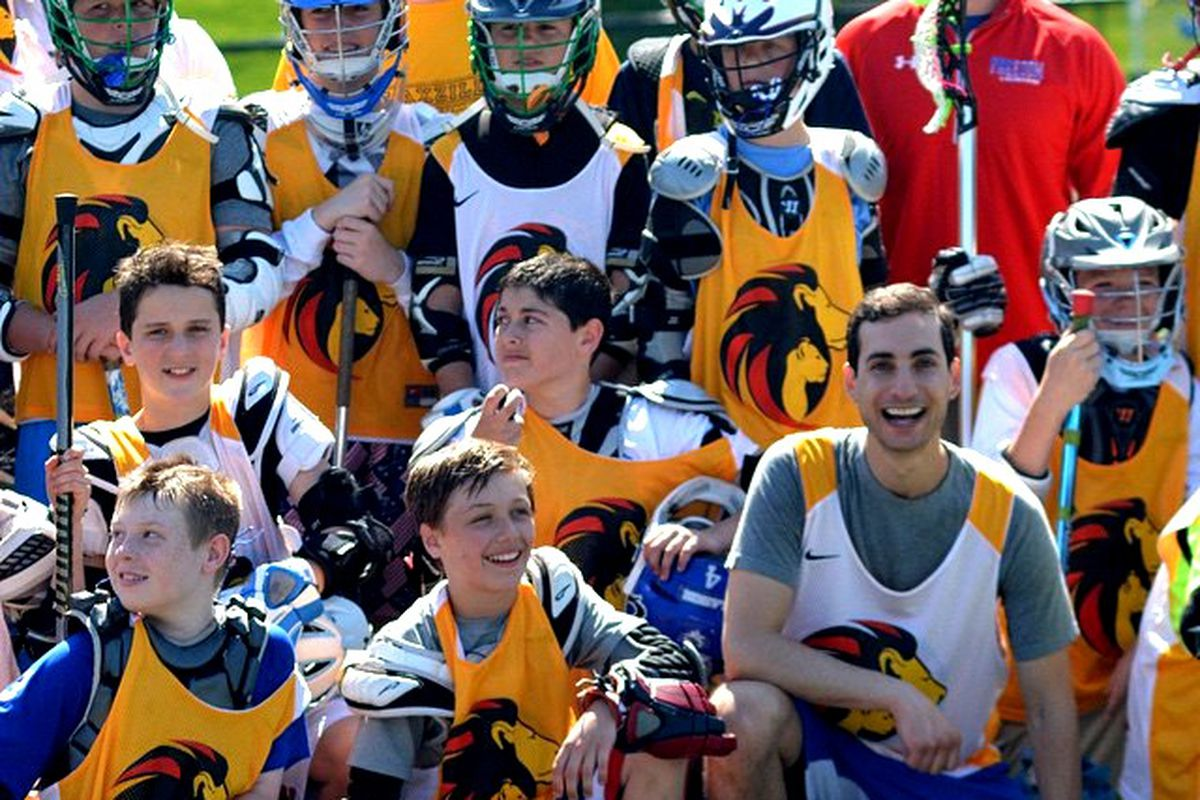 Andrew Goldstein (right) organized to help young gay lax player Braeden (center).