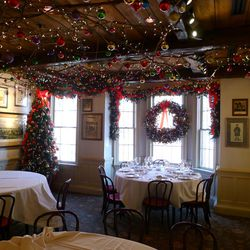 Upstairs in 1789's Middleburg room, Watts spent five hours stringing vines along the ceiling, then hung white lights and hundreds of Christmas ornaments from the vines, as he's done for the past 10 years.
