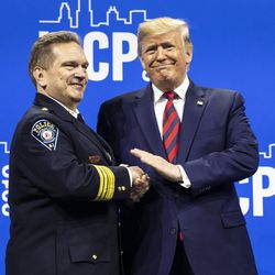 President Donald Trump shakes hands with Paul Cell, chief of police of Montclair State University and president of the International Association of Chiefs of Police, before speaking at the IACP convention at McCormick Place, Monday morning, Oct. 28, 2019.
