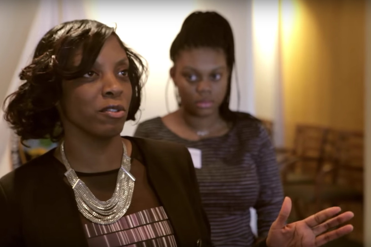 The author, principal Nadia Lopez, speaking with former U.S. Education Secretary Arne Duncan. (YouTube / U.S. Department of Education)