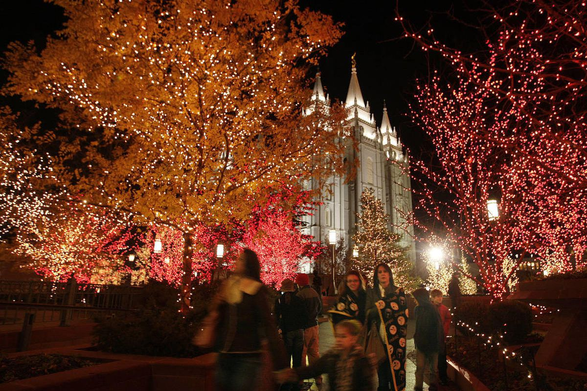 Downtown visitors walk through the  Church Plaza as Christmas lights are turned on downtown and at Temple Square in Salt Lake City  Friday, Nov. 25, 2011.