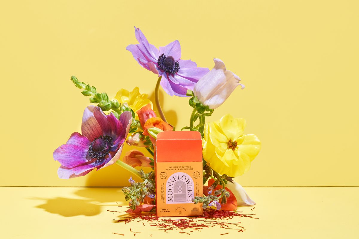 A Moonflowers box surrounded by purple flowers and a yellow background.