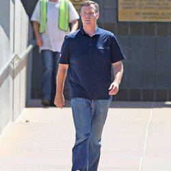 Former Utah Attorney General John Swallow leaves the Salt Lake County Jail after being booked and posting bond Tuesday, July 15, 2014, in South Salt Lake.