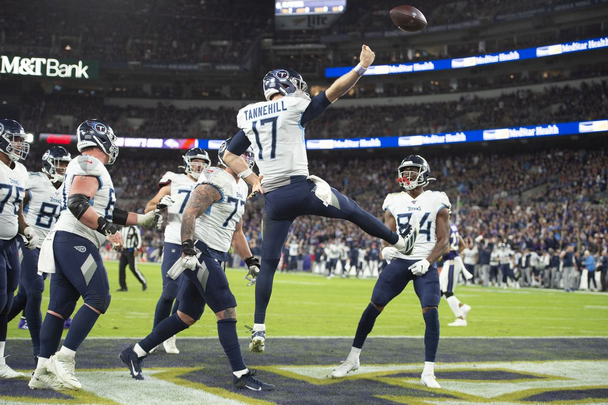 Tennessee Titans quarterback Ryan Tannehill celebrates after scoring a touchdown against the Baltimore Ravens in the second half in a AFC Divisional Round playoff football game at M&T Bank Stadium.