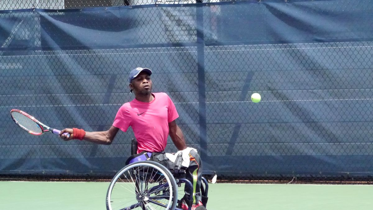 Saheed Adebayo Aare takes part in a Queens tennis tournament.
