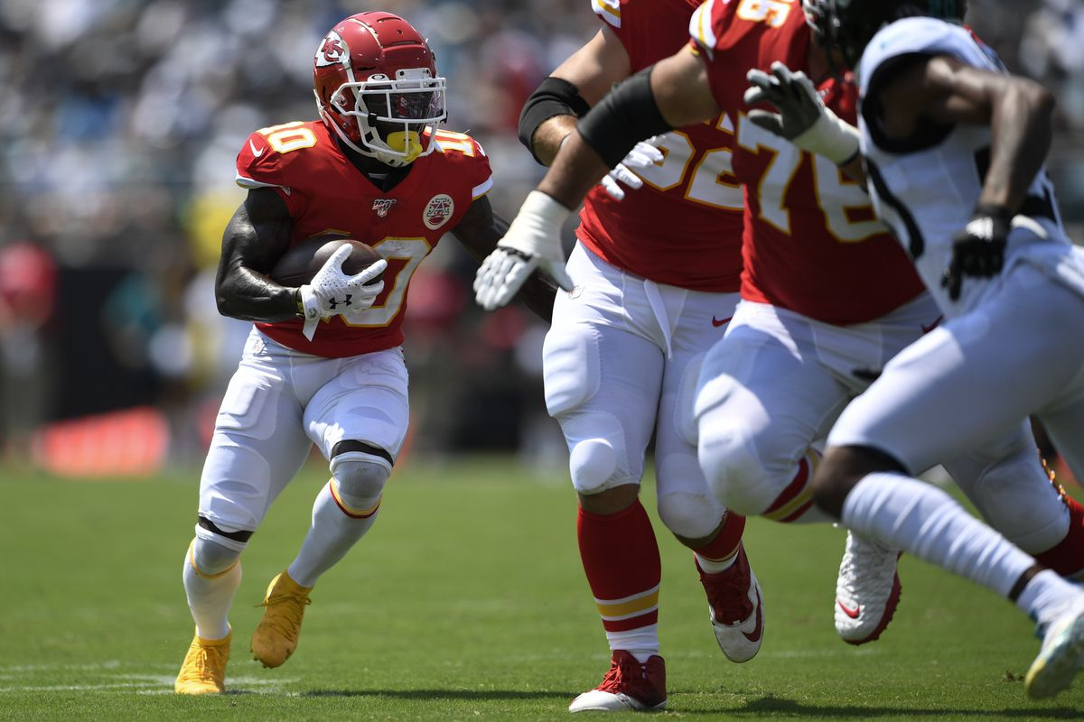 Kansas City Chiefs wide receiver Tyreek Hill runs the ball during the first quarter against the Jacksonville Jaguars at TIAA Bank Field.