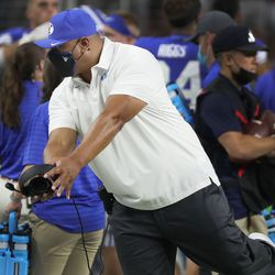 Brigham Young Cougars head coach Kalani Sitake shows how Brigham Young Cougars wide receiver Neil Pau'u (2) scored during the Vegas Kickoff Classic in Las Vegas on Saturday, Sept. 4, 2021. BYU won 24-16.
