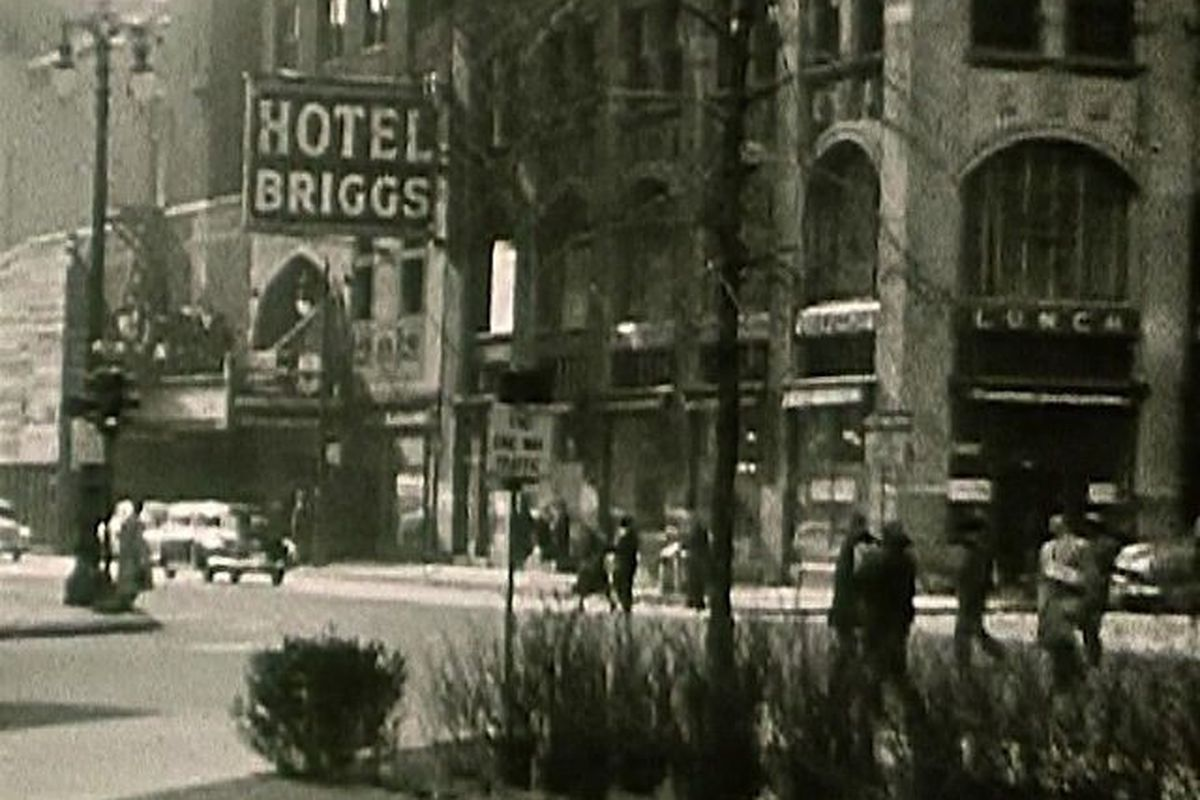 The facade revealed today is just beyond the Hotel Briggs sign in this undated photo.