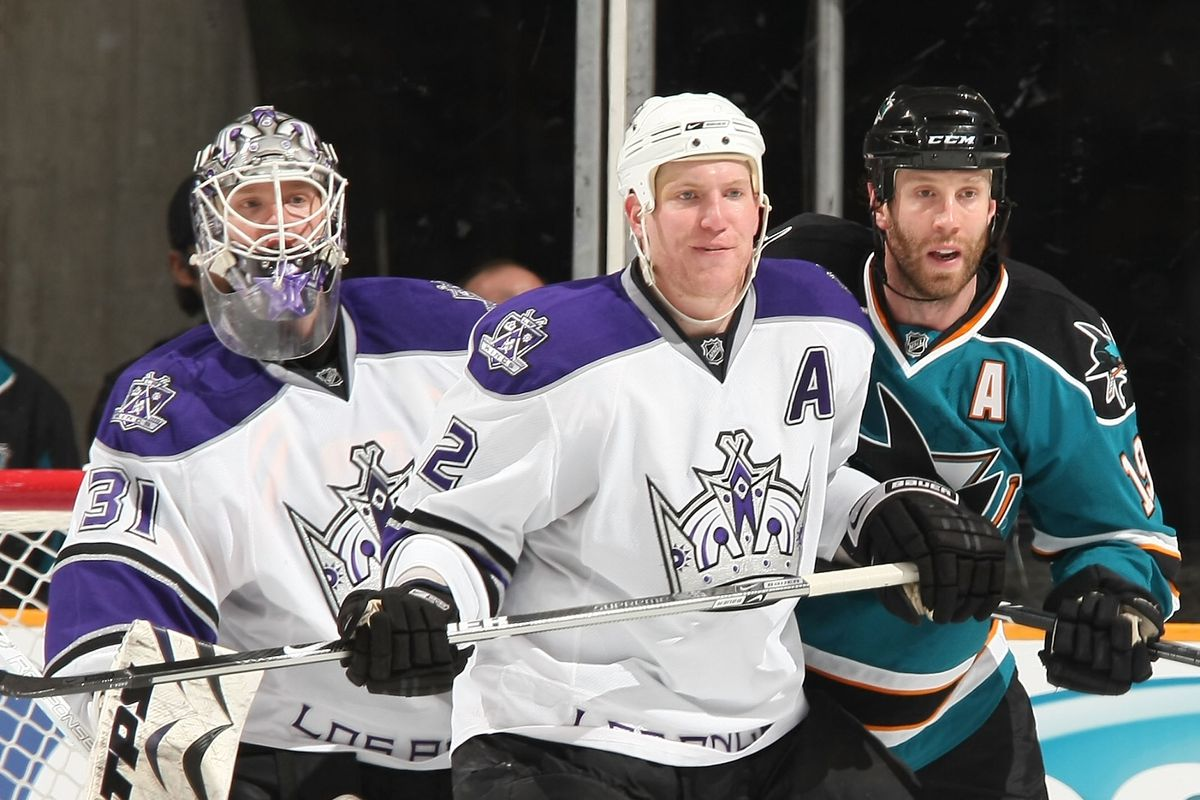 Matt Greene #2 and Erik Ersberg #31 of the Los Angeles Kings Stand guard defensively while Joe Thornton #19 of the San Jose Sharks looks for a pass during a NHL game on March 14, 2009 at HP Pavilion in San Jose, California.