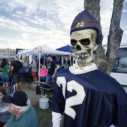 SOUTH BEND, IN - OCTOBER 21: A skeleton dressed in a Notre Dame Fighting Irish uniform hangs from a tree as fans tailgate prior to the game against the USC Trojans at Notre Dame Stadium on October 21, 2017 in South Bend, Indiana.