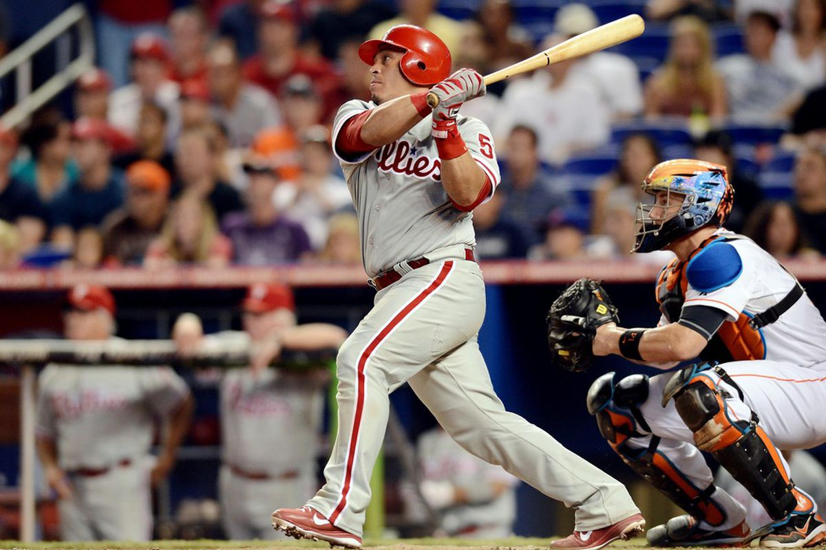 June 30, 2012; Miami, FL, USA; Philadelphia Phillies catcher Carlos Ruiz (51) connects for a double during the ninth inning against the Miami Marlins at Marlins Park. The Marlins won 3-2. Mandatory Credit: Steve Mitchell-US PRESSWIRE