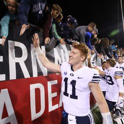 BYU quarterback Joe Critchlow high-fives fans after the Cougars' 31-21 win over UNLV on Friday, Nov. 10, 2017, at Sam Boyd Stadium in Las Vegas.