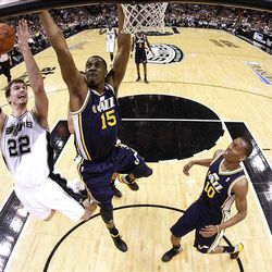 SAN ANTONIO, TX - APRIL 29:  Tiago Splitter #22 of the San Antonio Spurs takes a shot against Derrick Favors #15 of the Utah Jazz in Game One of the Western Conference Quarterfinals in the 2012 NBA Playoffs at AT&T Center on April 29, 2012 in San Antonio, Texas.