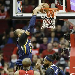 Utah Jazz center Rudy Gobert (27) dunks during the first half of an NBA basketball game against the Houston Rockets, Sunday, Feb. 9, 2020, in Houston.