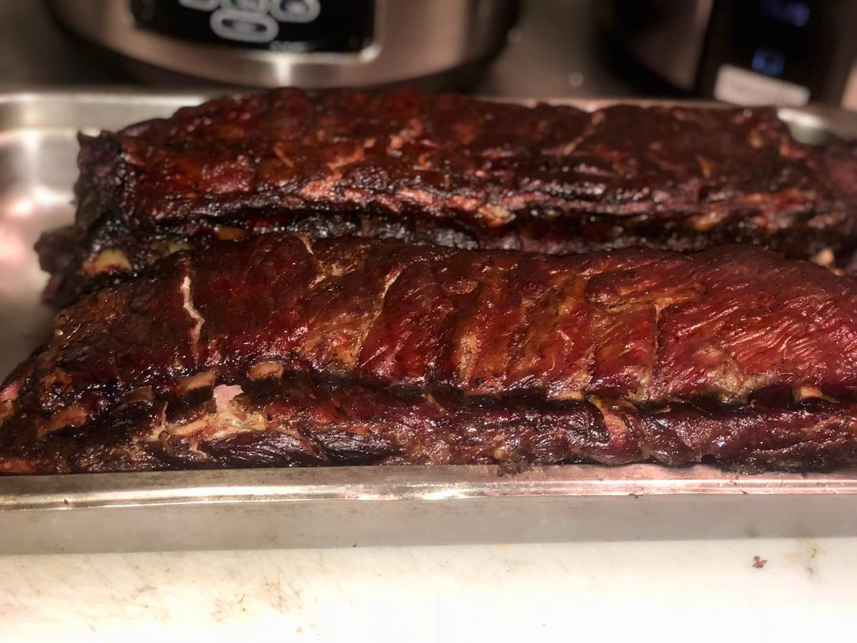 Smoked ribs lathered in barbecue sauce