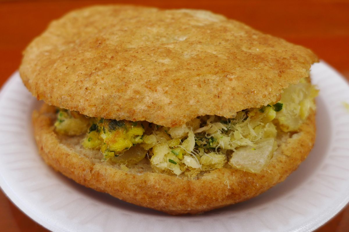 A round roll with a fish filling.