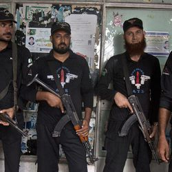 Pakistani police commandos stand guard at outside a court, where Muslim cleric Khalid Chishti, unseen, appeared in Islamabad, Pakistan on Sunday, Sept. 2, 2012. In the latest twist in a religiously charged case that has focused attention on the country's harsh blasphemy laws, Pakistani police arrested Chishti who they say planted evidence in the case of a Christian girl accused of blasphemy.
