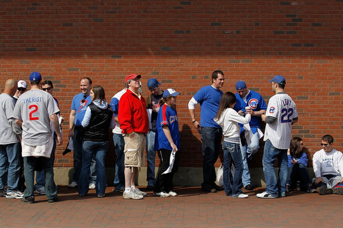CHICAGO: Fans of the Chicago Cubs wait to enter Wrigley Field before the Opening Day game between the Cubs and the Milwaukee Brewers on Opening Day at Wrigley Field in Chicago, Illininois. (Photo by Jonathan Daniel/Getty Images)