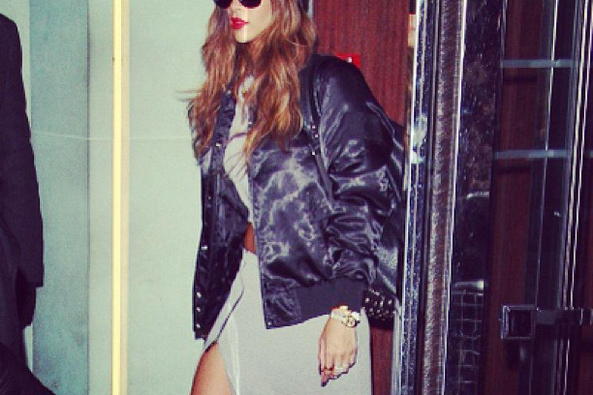 "Rihanna wearing her collection after her LFW show. Photo via River Island/<a href=""http://instagram.com/p/V2RZPJlC4k/"">Instagram</a>."
