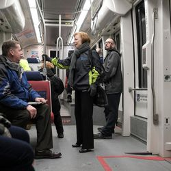Donna Spangler, communications director for the Utah Department of Environmental Quality, talks to a colleague on a TRAX train on her way to work in Salt Lake City on Thursday, Jan. 12, 2017.