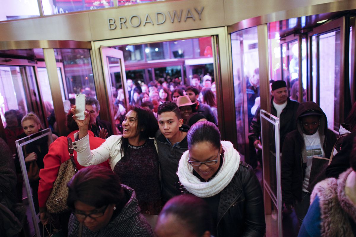 Black Friday shoppers enter the Macy's New York City flagship in 2015. The year prior, the store paid out a large racial discrimination settlement.