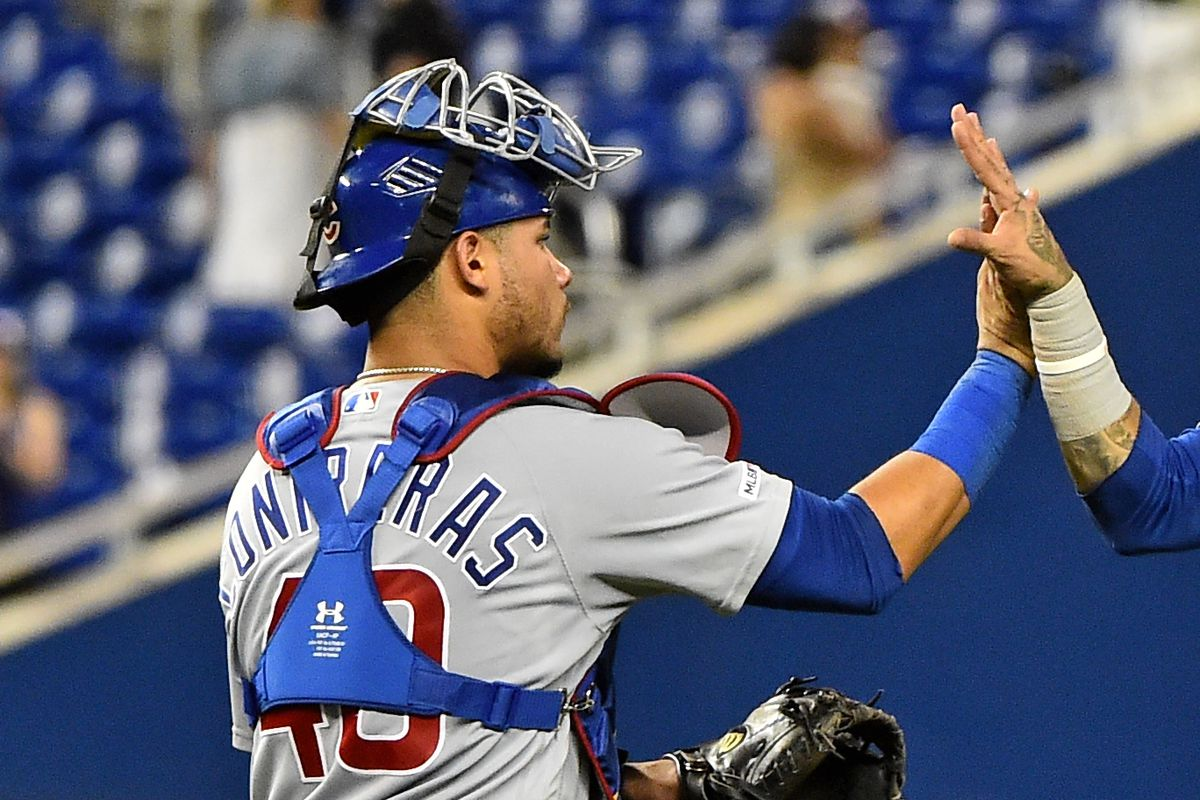 Chicago Cubs shortstop Javier Baez (9) and catcher Willson Contreras (40) celebrate after defeating the Miami Marlins at Marlins Park