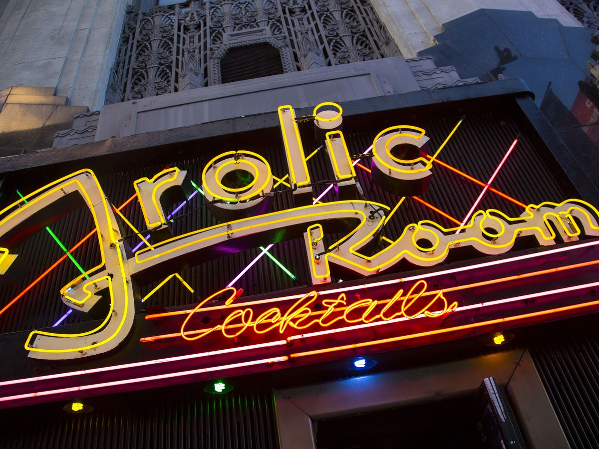 A neon sign that reads: Frolic Room cocktails.