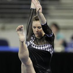 Alabama's Geralen Stack-Eaton competes on the balance beam during the NCAA women's individual gymnastics championships Sunday, April 22, 2012, in Duluth, Ga. Stack-Eaton won the event.