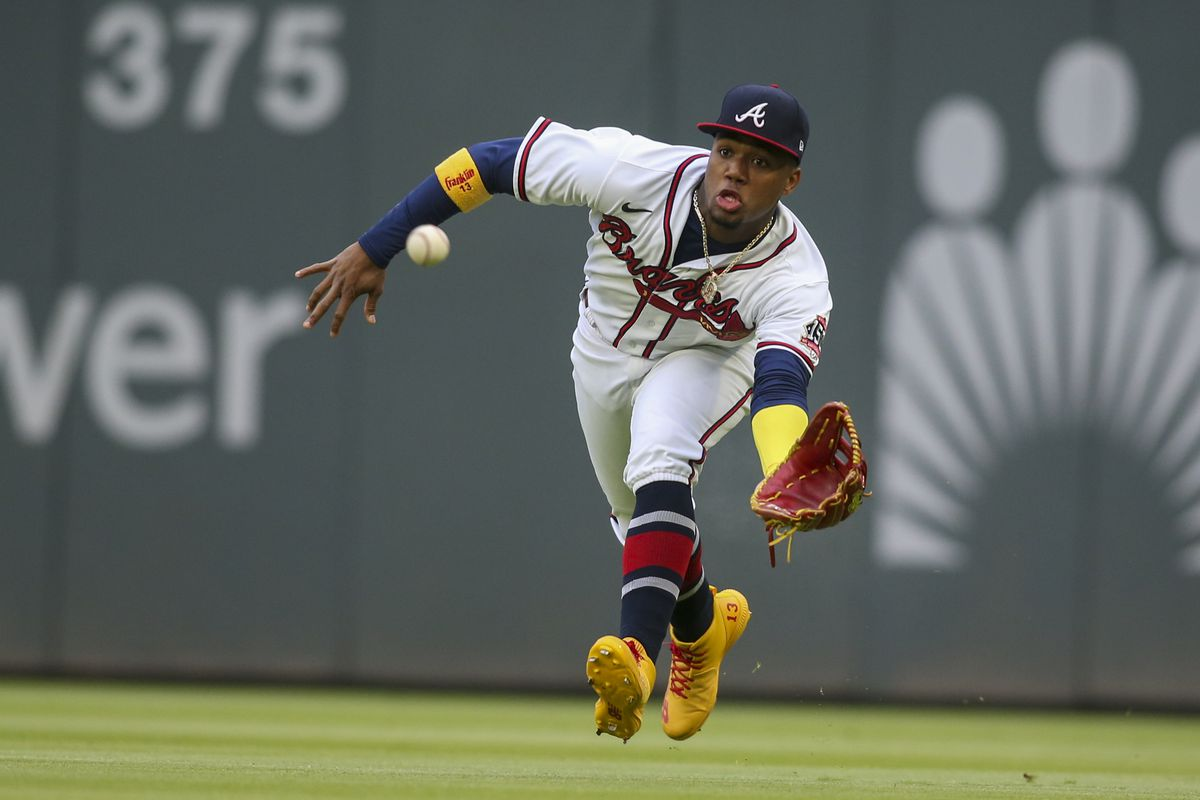 Atlanta Braves right fielder Ronald Acuna Jr. reaches for a fly ball against the Toronto Blue Jays during the first inning at Truist Park.