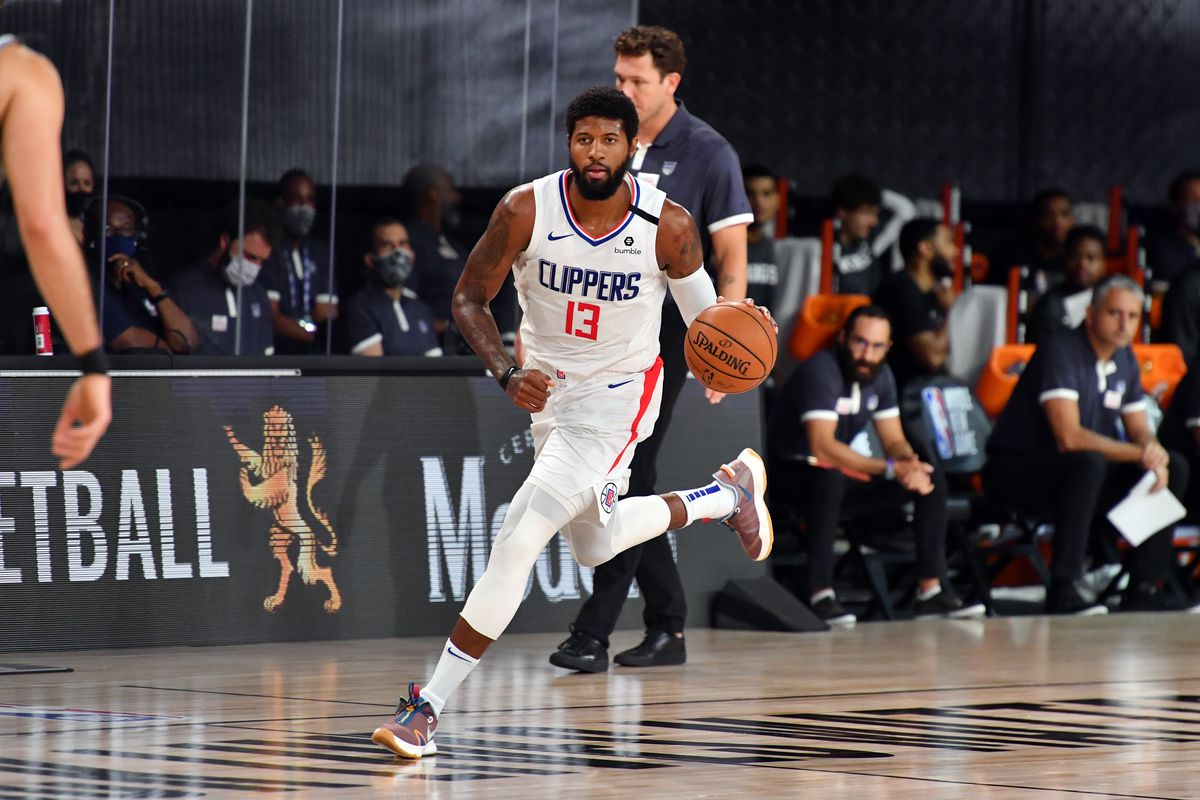 Paul George of the LA Clippers handles the ball during the game against the Sacramento Kings during a scrimmage on July 27, 2020 at The Arena at ESPN Wide World of Sports in Orlando, Florida.