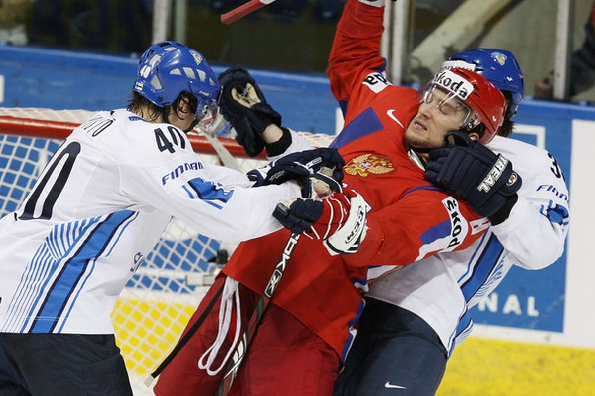 """Ovechin vs. a couple Finns at the WC's.  Canada faces Russia this morning at 11:00 am PST on TSN.  (via <a href=""""http://www3.pictures.gi.zimbio.com/World+Hockey+Championships+eRhvY0kHpSsl.jpg"""">www3.pictures.gi.zimbio.com</a>)"""