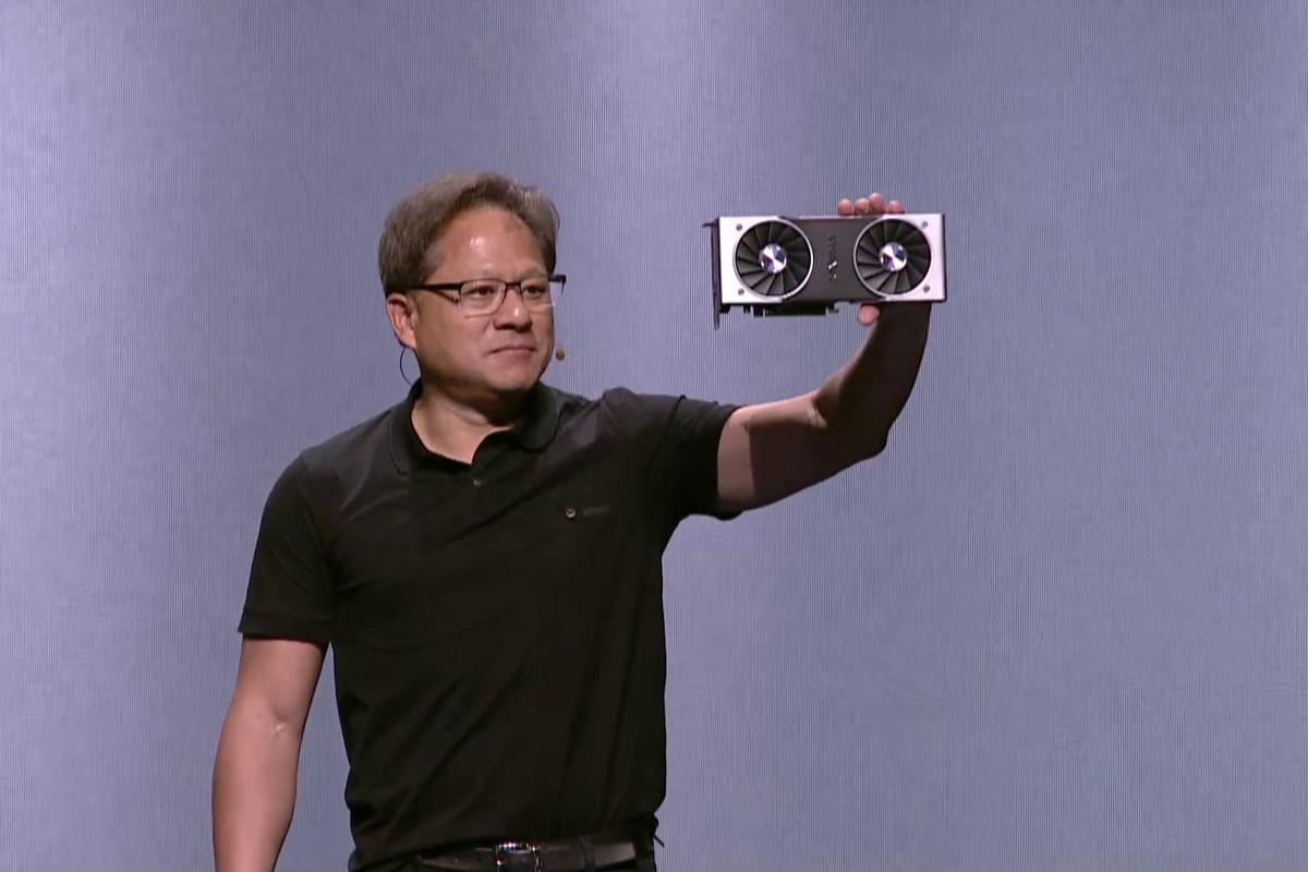 Nvidia CEO Jensen Huang holding Nvidia RTX GPU