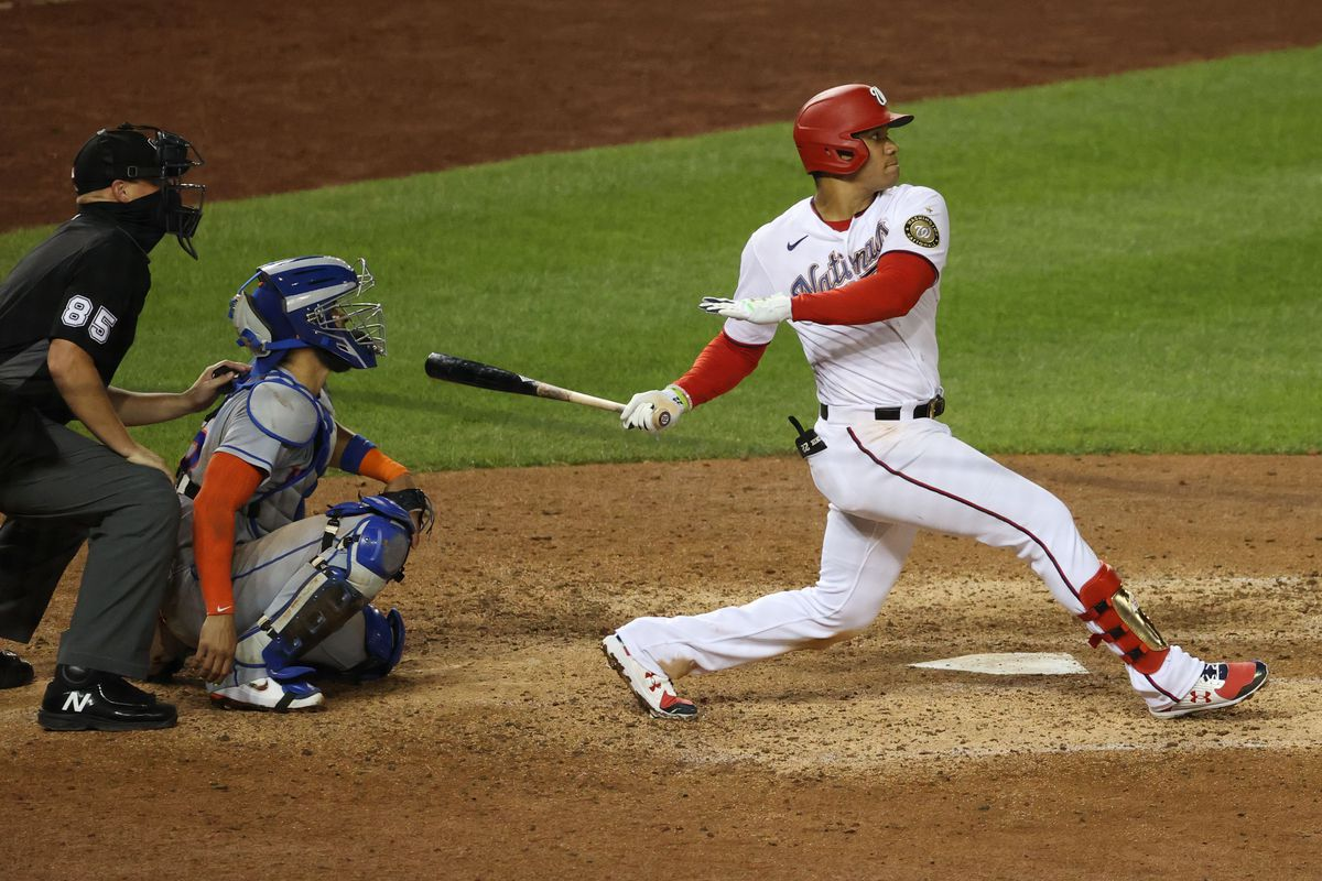 Washington Nationals left fielder Juan Soto hits a double against the New York Mets in the sixth inning at Nationals Park.