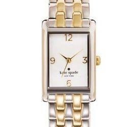 "Cooper Bracelet in two-toned gold, <a href=""http://www.katespade.com/cooper-bracelet/1YRU0038,default,pd.html?dwvar_1YRU0038_color=713&start=40&cgid=watches"">$225</a>."