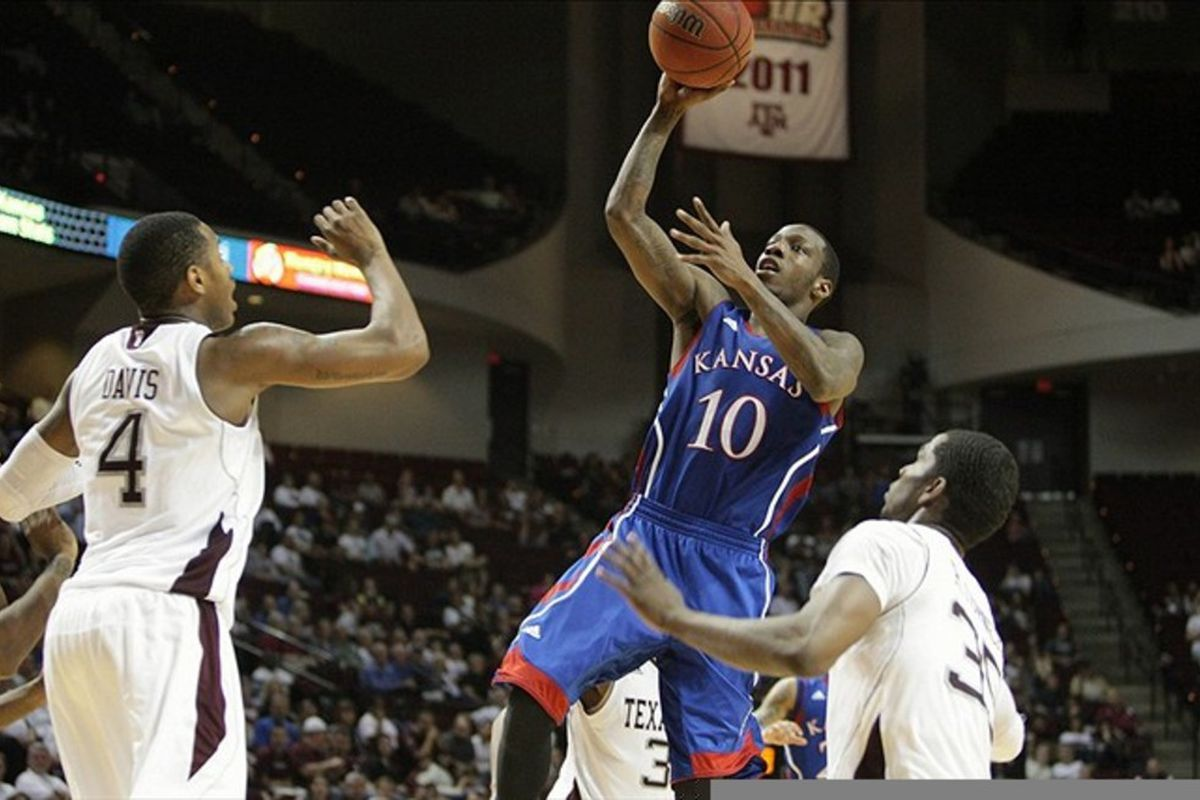 February 22, 2012; College Station, TX, USA; Kansas Jayhawks guard Tyshawn Taylor (10) attempts a shot in the second half against the Texas A&M Aggies at Reed Arena. Mandatory Credit: Troy Taormina-US PRESSWIRE