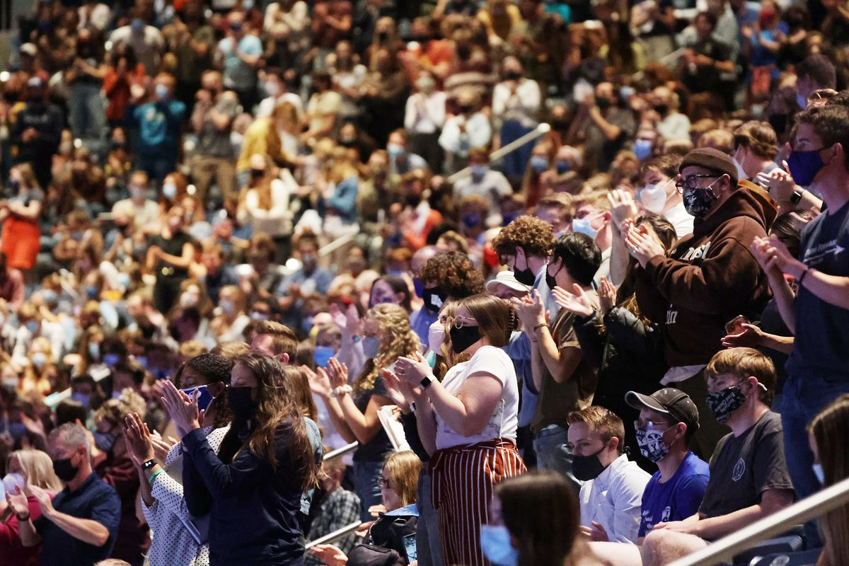 Students stand and applaud as Martin Luther King III speaks during a Brigham Young University forum at the Marriott Center in Provo on Tuesday, Sept. 28, 2021.