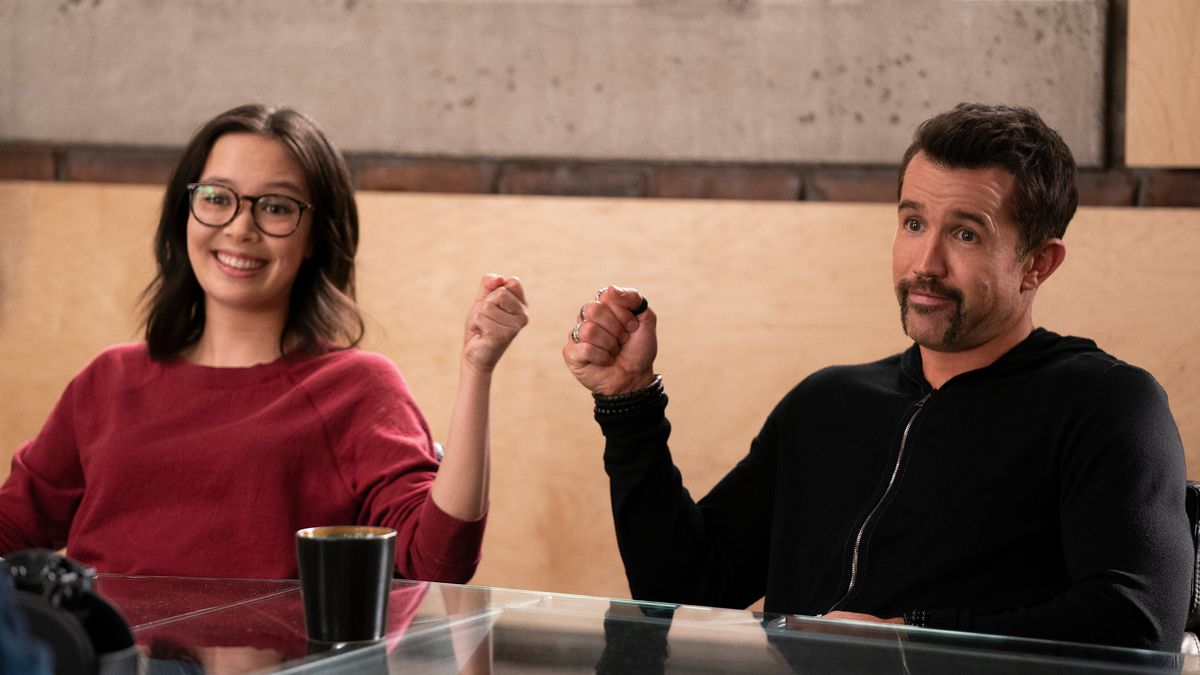 Poppy Li and Ian Grimm fist bump in a conference in Mythic Quest season 2