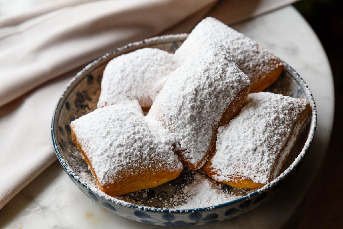 Beignets dusted in powdered sugar