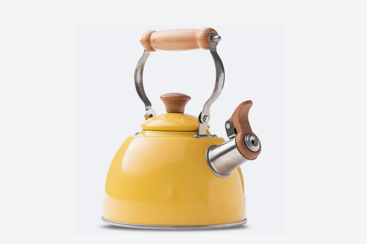 A bright yellow kettle with wooden handle