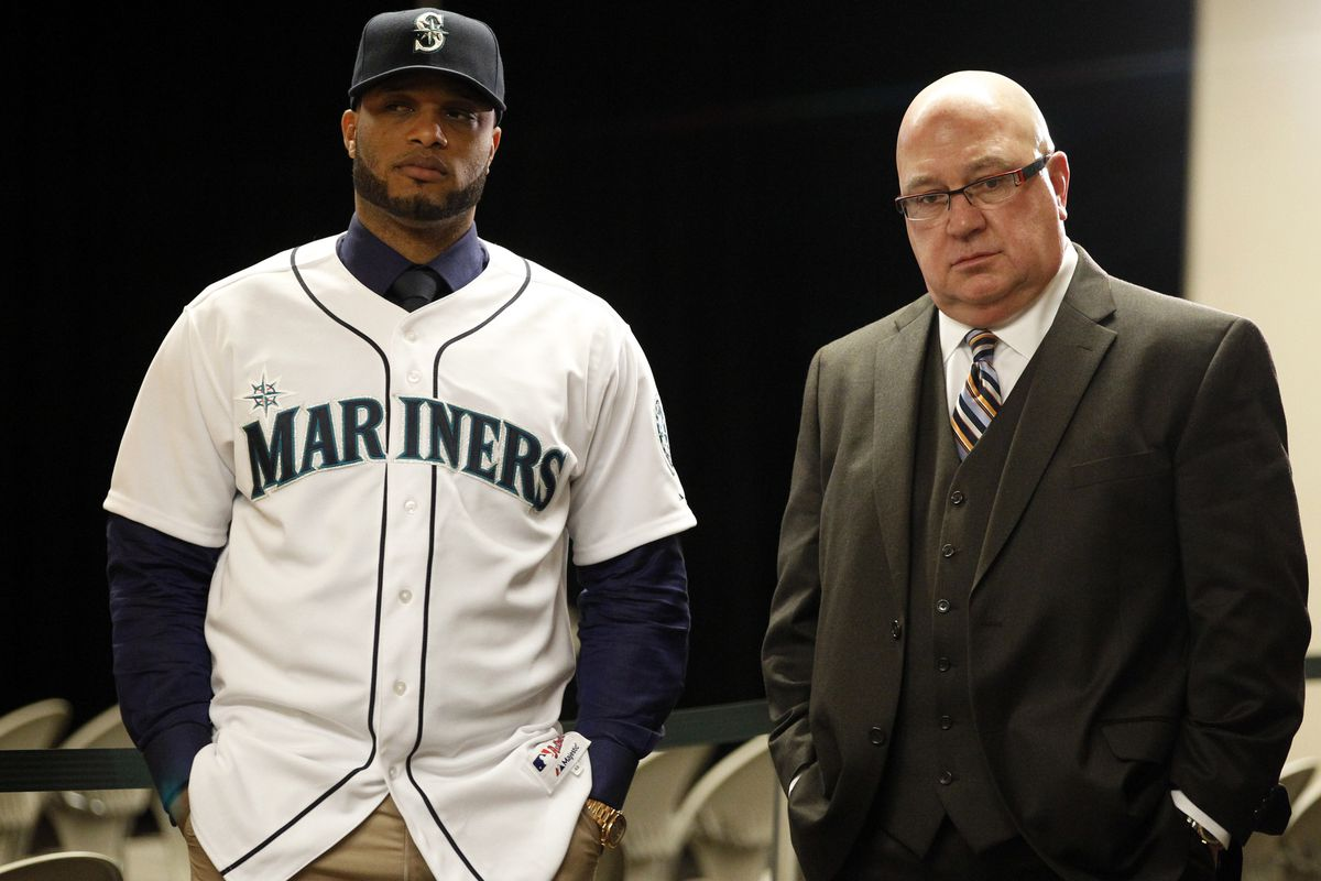 LEFT: A player, pictured immediately after signing a $240 million contract with the Mariners. RIGHT: A GM, immediately after signing one of the best players on the market. NOT PICTURED: Joy
