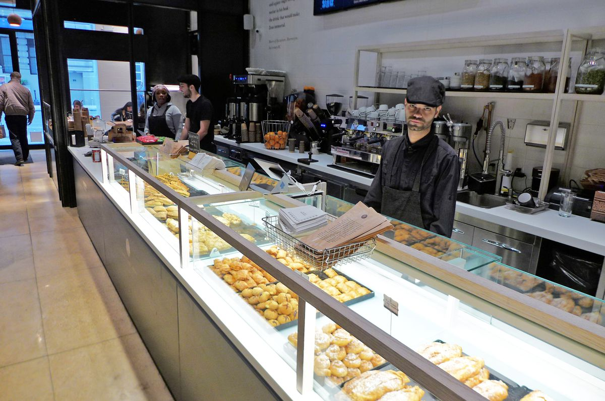 The pastry counter is long and well lit from below.