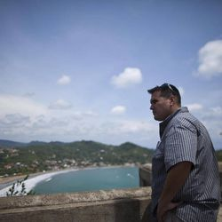 In this Aug. 31, 2012 photo, Jesse Pedro Resau, a friend of U.S. citizen Jason Sachary Puracal, stands at a viewpoint in San Juan del Sur, Nicaragua. As a three-judge appellate panel mulls the 35-year-old American's fate, the case has drawn the scrutiny of U.S. lawmakers and human-rights advocates, including the California Innocence Project, which works to absolve people who have been wrongfully convicted. In late 2010 masked policemen raided his seafront real estate office and took him to Nicaragua's maximum security prison. Prosecutors charged that Puracal was using his business as a front for money laundering in a region used to transport cocaine from Colombia to the United States. Because no drugs or cash were seized, Puracal's family and friends thought he wouldn't be held long, but nine months later, a judge convicted Puracal and sentenced him to 22 years in prison.