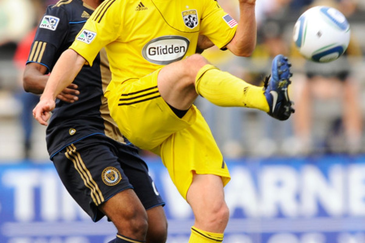 COLUMBUS OH - OCTOBER 24:  Robbie Rogers #18 of the Columbus Crew keeps control of the ball in front of Sheanon Williams #25 of the Philadelphia Union on October 24 2010 at Crew Stadium in Columbus Ohio.  (Photo by Jamie Sabau/Getty Images)