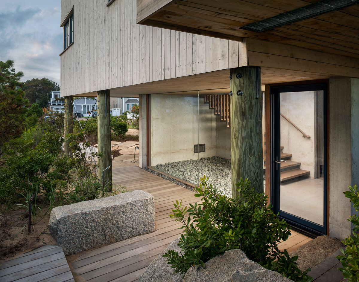 Wooden walkway next to house