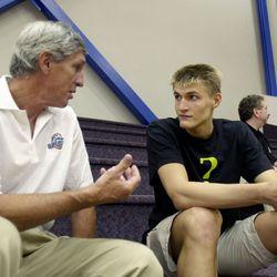 Coach Jerry Sloan talks with Andrei Kirilenko at Franklin Covey Field.