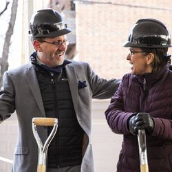 Steppenwolf Theatre executive director David Schmitz hugs Anna Shapiro, artistic director of Steppenwolf, after the company breaks ground on a campus expansion and unveils plans for a new theater building on Halsted Street, Tuesday, March 5, 2019. | Ashlee Rezin/Sun-Times