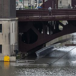 The Chicago River overflowed its banks and flooded the Riverwalk after overnight showers and thunderstorms across the city, Monday morning, May 18, 2020.