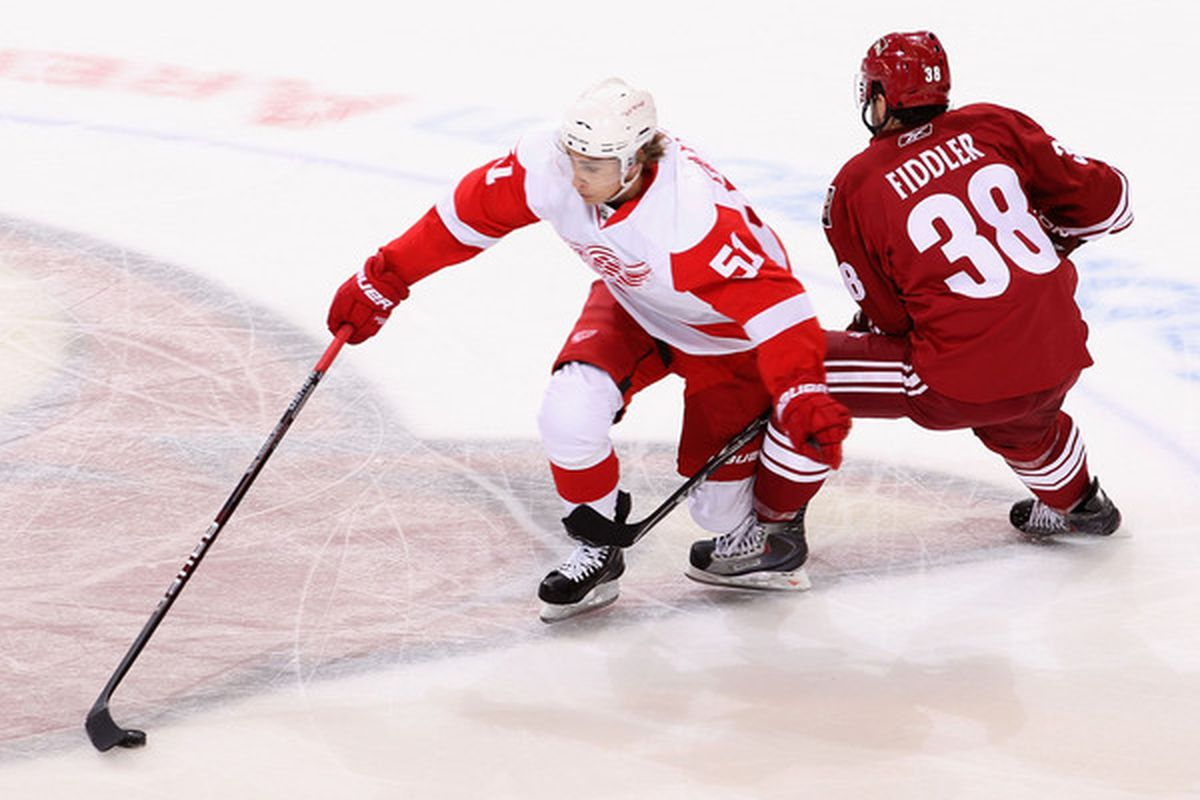 The Red Wings best player in the first period, Vernon Fiddler, with an obviously legal knee on knee hit. Other player pictured unknown. (Photo by Christian Petersen/Getty Images)