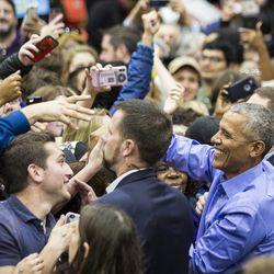 Former President Barack Obama greets supporters  Sunday at the University of Illnois at Chicago. | Ashlee Rezin/Sun-Times