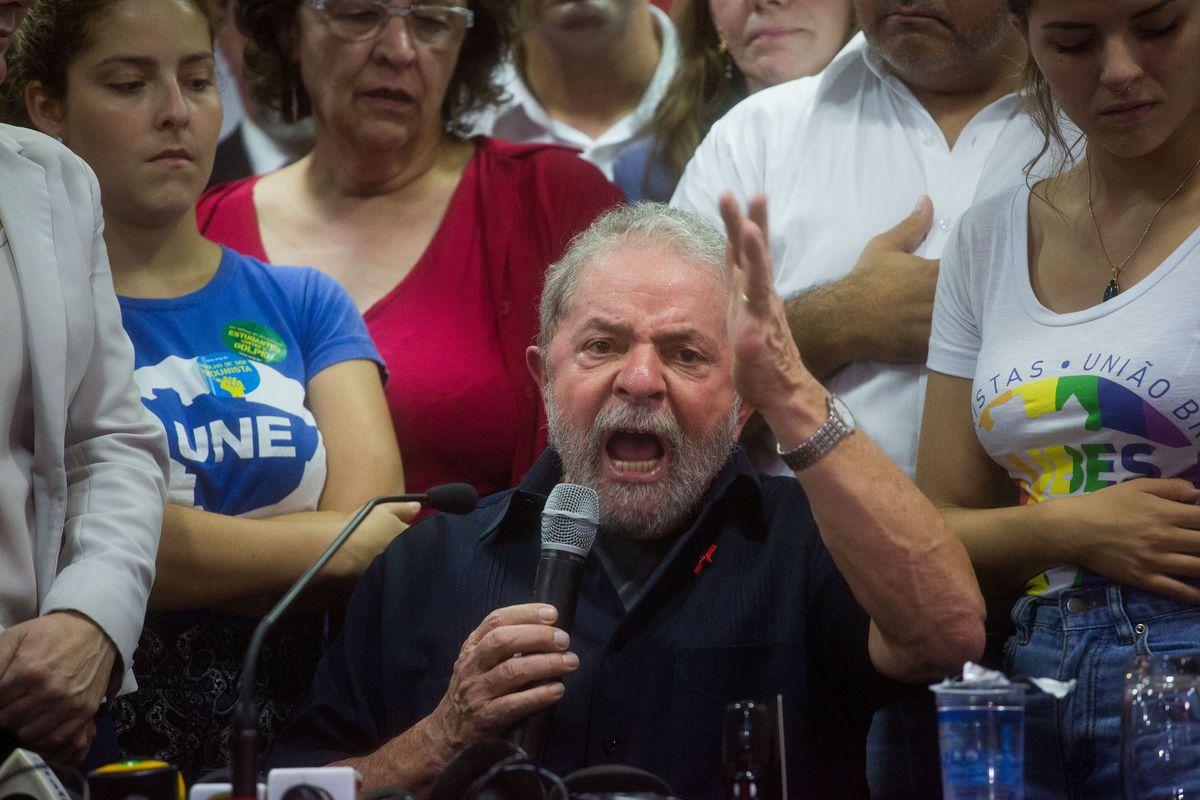 The former president of Brazil, Luiz Inacio Lula da Silva, faces press questions about a corruption scandal, in March.